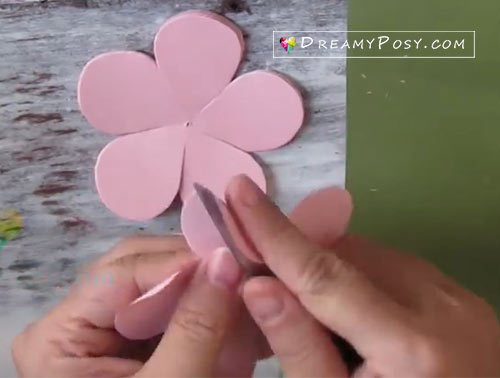 Easy tutorial to make a paper rose free template step 2 use the edge of the scissor to curve the petal mightylinksfo